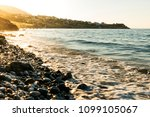 stony beach with waves and with ... | Shutterstock . vector #1099105067