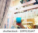 holding a plastic glass of iced ... | Shutterstock . vector #1099131647
