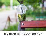 a cup of mojito stands on the... | Shutterstock . vector #1099185497