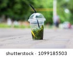 a cup of mojito stands on the... | Shutterstock . vector #1099185503