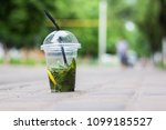 a cup of mojito stands on the... | Shutterstock . vector #1099185527