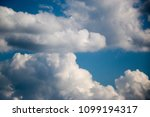 white clouds against the blue...   Shutterstock . vector #1099194317