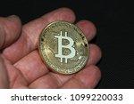 golden bitcoin in a man's hand. ... | Shutterstock . vector #1099220033