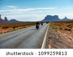 bikers riding to monument valley | Shutterstock . vector #1099259813