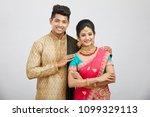 attractive happy north indian...   Shutterstock . vector #1099329113
