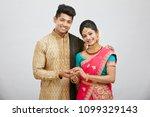 attractive happy north indian...   Shutterstock . vector #1099329143