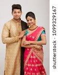 attractive happy north indian...   Shutterstock . vector #1099329167
