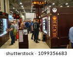 Small photo of Dallas, TX / USA - 5/4/2018: Attendees at the 147th NRA annual meeting held at the Kay Bailey Hutchisons convention center examine the offerings of Ruger Firearms.