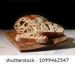 freshly baked bread on wooden... | Shutterstock . vector #1099462547