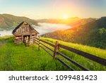 majestic view on beautiful fog... | Shutterstock . vector #1099481423