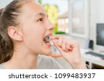 teenager with braces on her... | Shutterstock . vector #1099483937