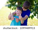 happy young boys have fun... | Shutterstock . vector #1099489913