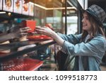 smiling lady is receiving order ... | Shutterstock . vector #1099518773