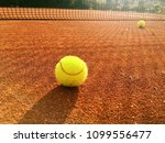 tennis ball on the clay court....   Shutterstock . vector #1099556477