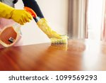 housemaid hands cleans table... | Shutterstock . vector #1099569293
