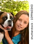 Young lad with a boxer/Girl and Dog/Girl holding her best friend - stock photo