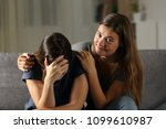 bad teen is happy with her sad... | Shutterstock . vector #1099610987