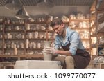 young master at the potter's... | Shutterstock . vector #1099770077
