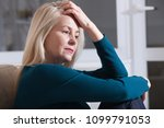 sad depressed woman at home... | Shutterstock . vector #1099791053