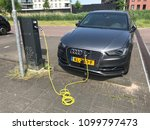 Small photo of Amsterdam, Netherlands - May 27, 2018: Audi A3 Sportback E-Tron electric car being charged at a Allego charge point.