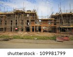 Building of new housing estate with scaffolding in Bristol, UK - stock photo