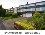 Typical 1970s terrace houses with garden in Bristol, UK - stock photo