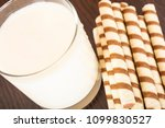 a glass of yogurt with a waffle ... | Shutterstock . vector #1099830527