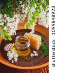 jar of acacia honey with a... | Shutterstock . vector #1099848923