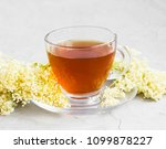 elderflower tea cup with... | Shutterstock . vector #1099878227