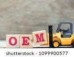 toy forklift hold letter block... | Shutterstock . vector #1099900577