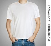 White t-shirt on a young man template on gray background - stock photo