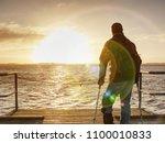happy disabled man on bridge... | Shutterstock . vector #1100010833