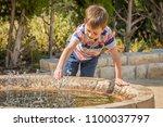 happy cute caucasian kid...   Shutterstock . vector #1100037797