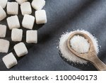 cubes and refined sugar powder  ... | Shutterstock . vector #1100040173
