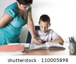Schoolboy Studying In Classroom With Teacher,back to school concept - stock photo
