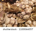 clusters of delicious garlic... | Shutterstock . vector #1100066057