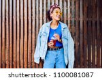 happy mixed race female with...   Shutterstock . vector #1100081087