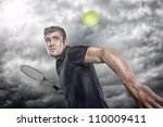 Tennis player in front of dramatic sky - stock photo