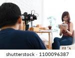 man use compact camera...   Shutterstock . vector #1100096387