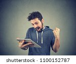cheerful bearded man in hoodie... | Shutterstock . vector #1100152787