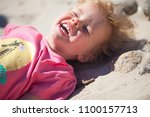 little  girl l at the beach... | Shutterstock . vector #1100157713