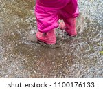 Small photo of child jumping in a buddle