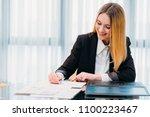 business woman at office.... | Shutterstock . vector #1100223467