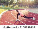 young woman doing sports at the ... | Shutterstock . vector #1100257463
