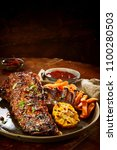 tasty portion of barbecued... | Shutterstock . vector #1100280503
