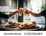 two friends toasting with...   Shutterstock . vector #1100286683