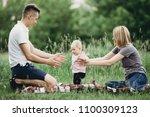 baby girl doing first steps.... | Shutterstock . vector #1100309123
