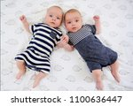 two adorable twin babies posing ... | Shutterstock . vector #1100636447