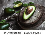 avocado. healthy food on the... | Shutterstock . vector #1100654267