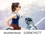 fitness young woman with bike...   Shutterstock . vector #1100674277